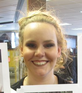 MSC-Plymouth student Sam models a messy updo and glamorous eye makeup.