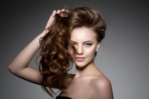 Model with long hair. Waves Curls Hairstyle. Hair Salon. Updo. F