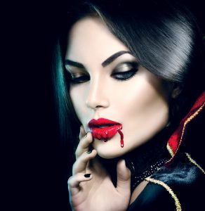 Vampire Halloween Woman portrait. Beauty Sexy Vampire Girl with