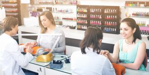 Successful nail technicians performing services