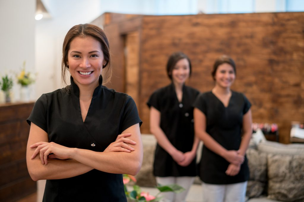 Massage therapist and peers at spa