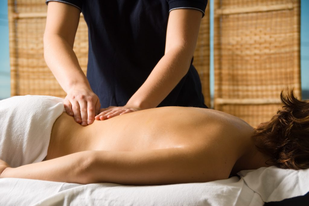 Client in spa recieiving massage for health problems
