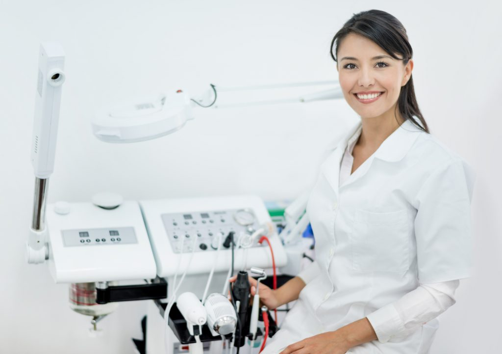 Dermatologist working at her practice or spa using laser or dermabrasion machines