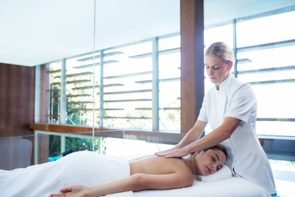 Woman receiving massage for stress relief