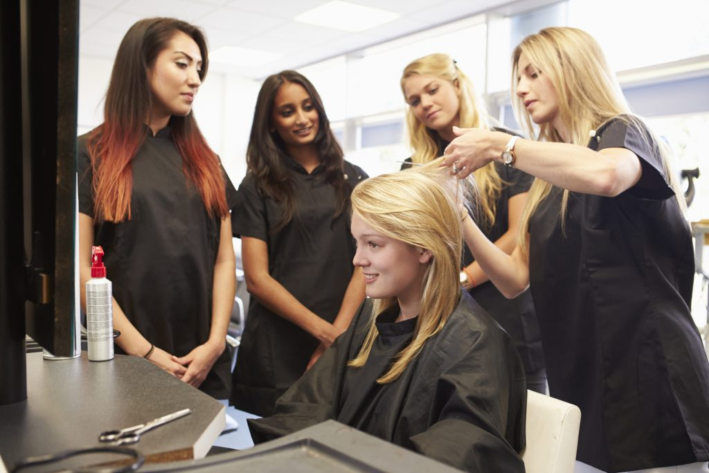 Cosmetology class teaching next generation of hairstylists