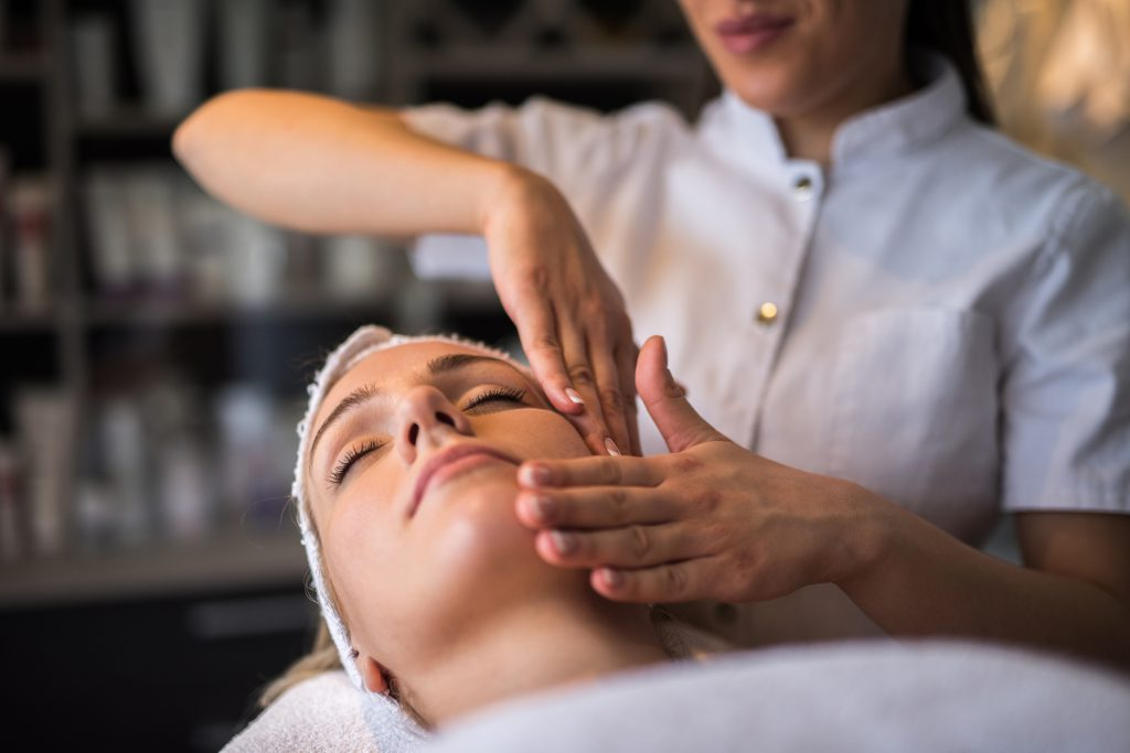 Woman who has received her diploma in esthiology performs spa services