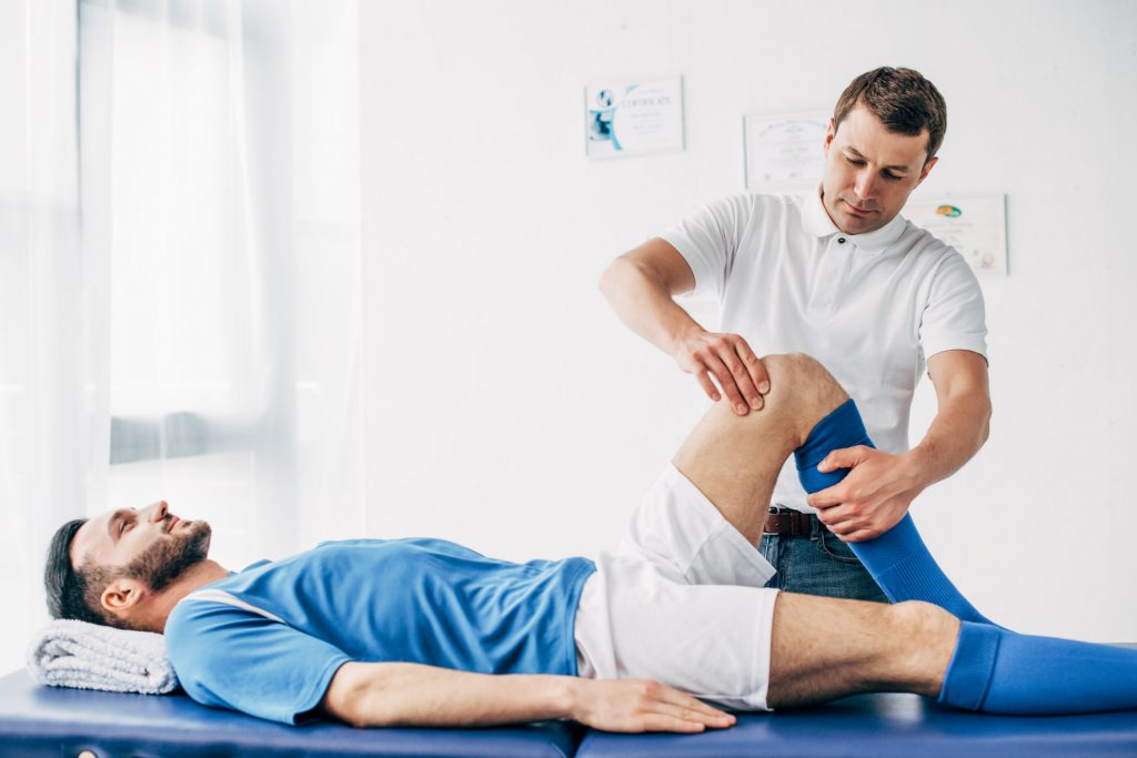 Athlete receiving sports massage therapy.